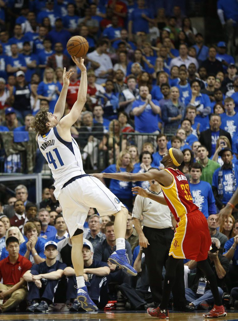 Dallas Mavericks forward Dirk Nowitzki (41) shoots a fadeaway jumper over Houston Rockets guard Jason Terry (31) during the second half of game 4 of the first round of the NBA playoffs at American Airlines Center in Dallas on Sunday, April 26, 2015. The Dallas Mavericks defeated the Houston Rockets 121-109 to avoid a sweep and bring the series to 3-1. (Vernon Bryant/The Dallas Morning News)