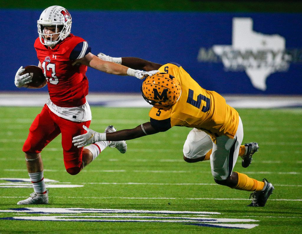 McKinney Boyd's Jake Fex (13) works to break away from McKinney's Jalon Rocquemore (5) during the second half of a high school football matchup between McKinney and McKinney Boyd at McKinney ISD Stadium on Friday, Nov. 8, 2019 in McKinney, Texas. (Ryan Michalesko/The Dallas Morning News)