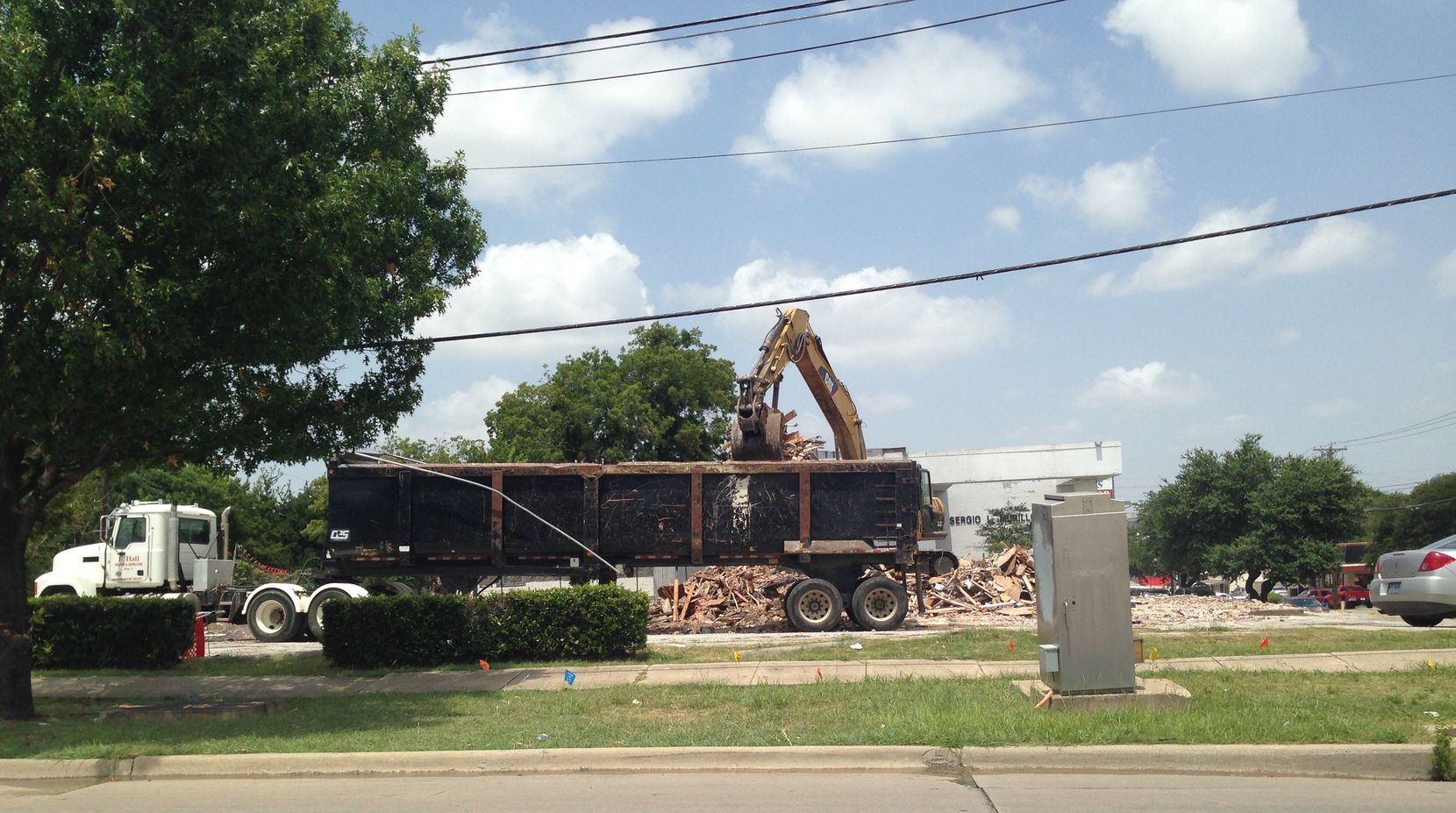 Demolition crews recently knocked down a building on the corner of Maple and Wycliff, one of the properties sold to developers.