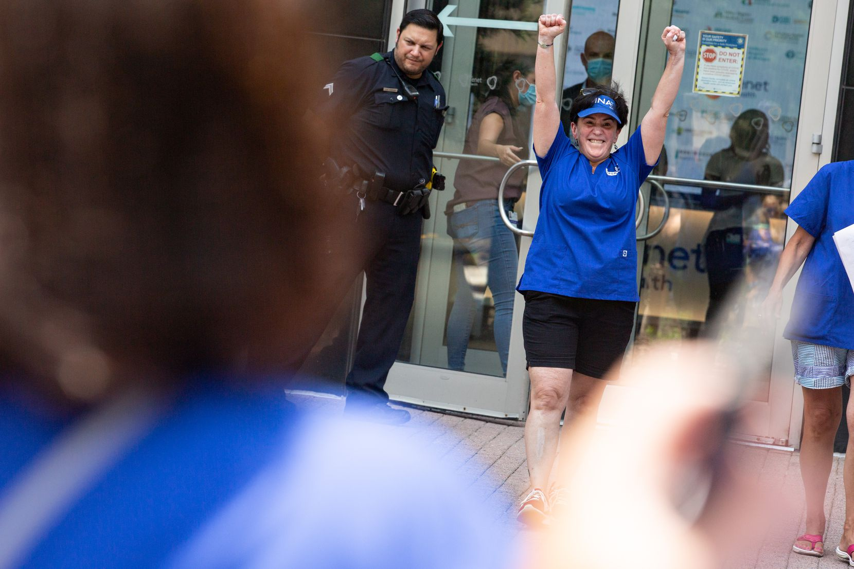 Striking nurse Marie Ritacco celebrates after delivering a petition signed by 700 nurses to Tenet Healthcare's corporate office.