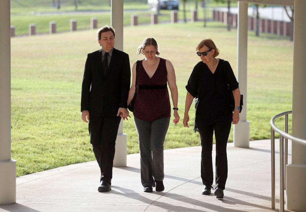 Defendant Michael Thedford walks into the Collin County Courthouse while holding hands with his wife, Jennifer Thedford, who is accompanied by her mother, Kathy Becker, in McKinney on Friday, July 20, 2018.