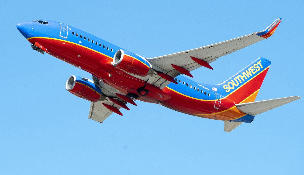 A Southwest Airlines jet takes off. An airline employee is being praised for tracking down a piece of luggage containing important medication.