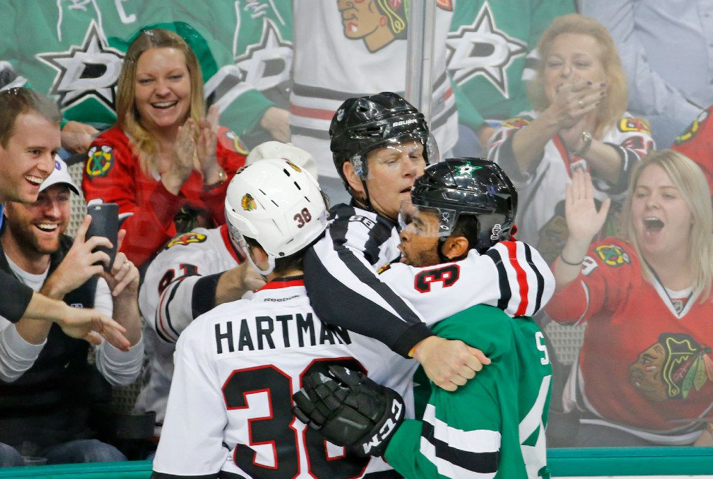 Fans enjoy getting an up close look at the skirmish between Dallas Stars center Gemel Smith (46) and Chicago Blackhawks right wing Ryan Hartman (38) in the third period during the Chicago Blackhawks vs. the Dallas Stars NHL hockey game at the American Airlines Center in Dallas on Saturday, November 5, 2016. (Louis DeLuca/The Dallas Morning News)