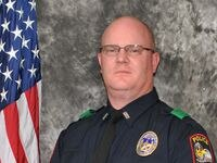 Officer Andy MacDonald died Monday from complications associated with COVID-19, Grand Prairie police said.