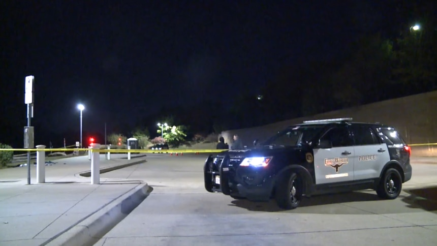 Police investigate the aftermath of a fatal shooting at TRE's Centreport/DFW Airport station in Fort Worth, in an image taken from footage shot by Metro Video Dallas/Fort Worth.