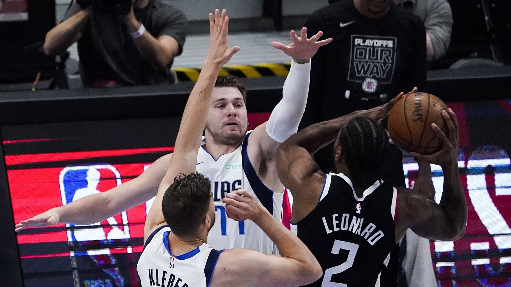 Dallas Mavericks guard Luka Doncic (77) and forward Maxi Kleber (42) defend against LA Clippers forward Kawhi Leonard (2) during the first quarter of an NBA playoff basketball game at American Airlines Center on Sunday, May 30, 2021, in Dallas.