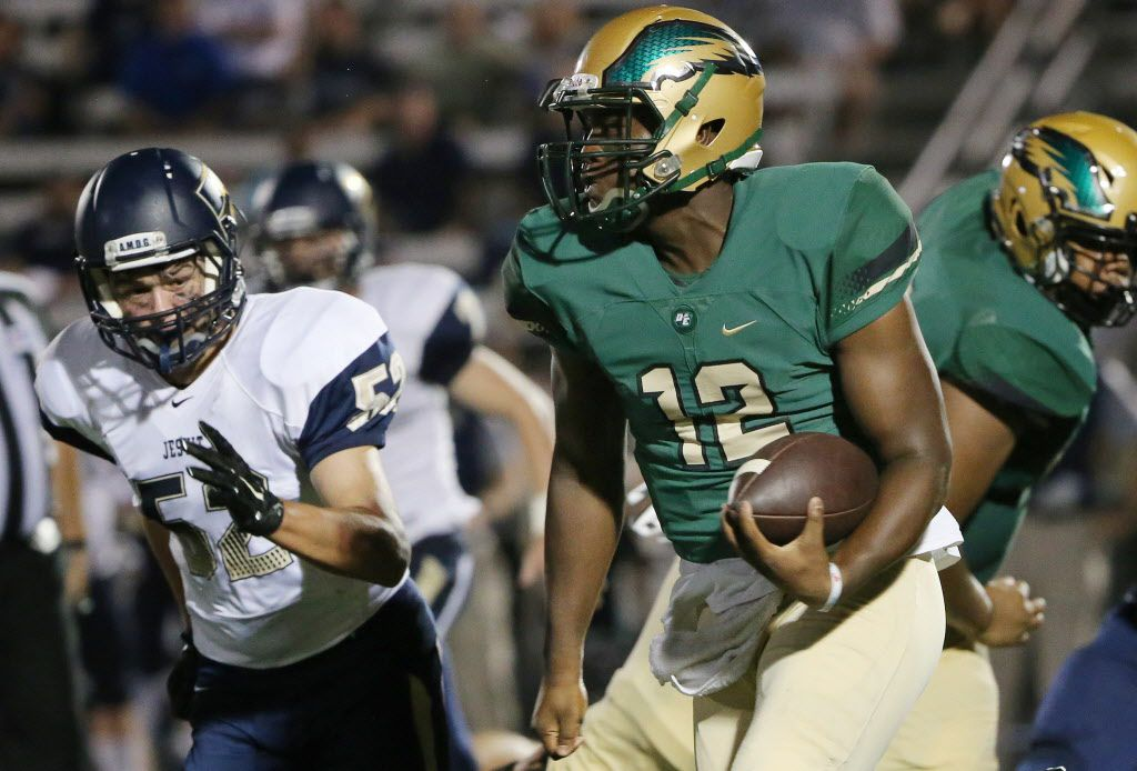 DeSoto quarterback Courtney Douglas (12) rushes 36 yards with Jesuit linebacker Tommy Paredes (52) nearby to start the fourth quarter during a high school football game between Jesuit and DeSoto at Eagle Stadium in DeSoto, Texas Friday August 28, 2016. DeSoto beat Jesuit 47-13. (Andy Jacobsohn/The Dallas Morning News)