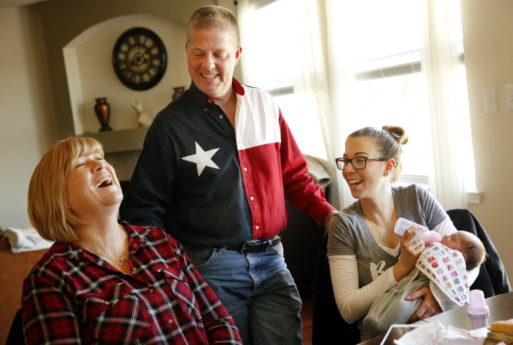 Tracey Thompson (left), the 54-year-old Collin County woman who gave birth to her granddaughter Kelcey McKissack (right) as a surrogate mother, shares a laugh while telling stories of the birth with her husband, Ben Thompson, and daughter Kelley McKissack at McKissack's home in Wylie. (Tom Fox/Staff Photographer)