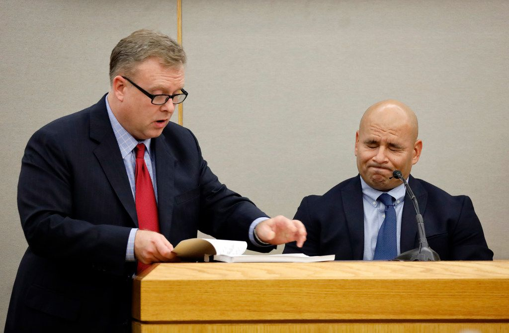 Dallas police Officer Martin Rivera, the former police partner of Amber Guyger, reacts as Assistant District Attorney Jason Hermus shows him his texts and Snapchat records while Rivera testifies on the witness stand.