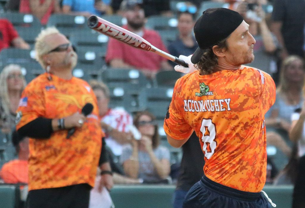 Actor Matthew McConaughey takes some swings during the Red River celebrity softball game home run contest at the Dr. Pepper Ballpark in Frisco, Texas. (Louis DeLuca/The Dallas Morning News)