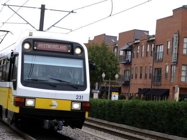 A DART train passes by the Eastside Village, in Plano.