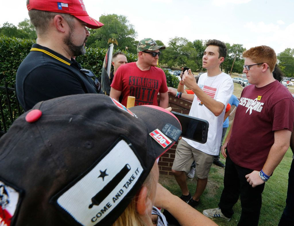 From left: Jason Van Dyke and Bryan Alcorn debate with David Hogg and Matt Deitsch with March For Our Lives as a panel with other students from Stoneman Douglas High School from Parkland, Fla., goes on at Paul Quinn College in Dallas on July 7, 2018.