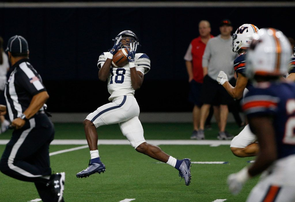 Frisco Lone Star receiver Marvin Mims (18) catches a pass on the first play of the game for touchdown against Frisco Wakeland during the first half of their high school football game in Frisco, Texas on January 1, 2019. (Michael Ainsworth/Special Contributor)