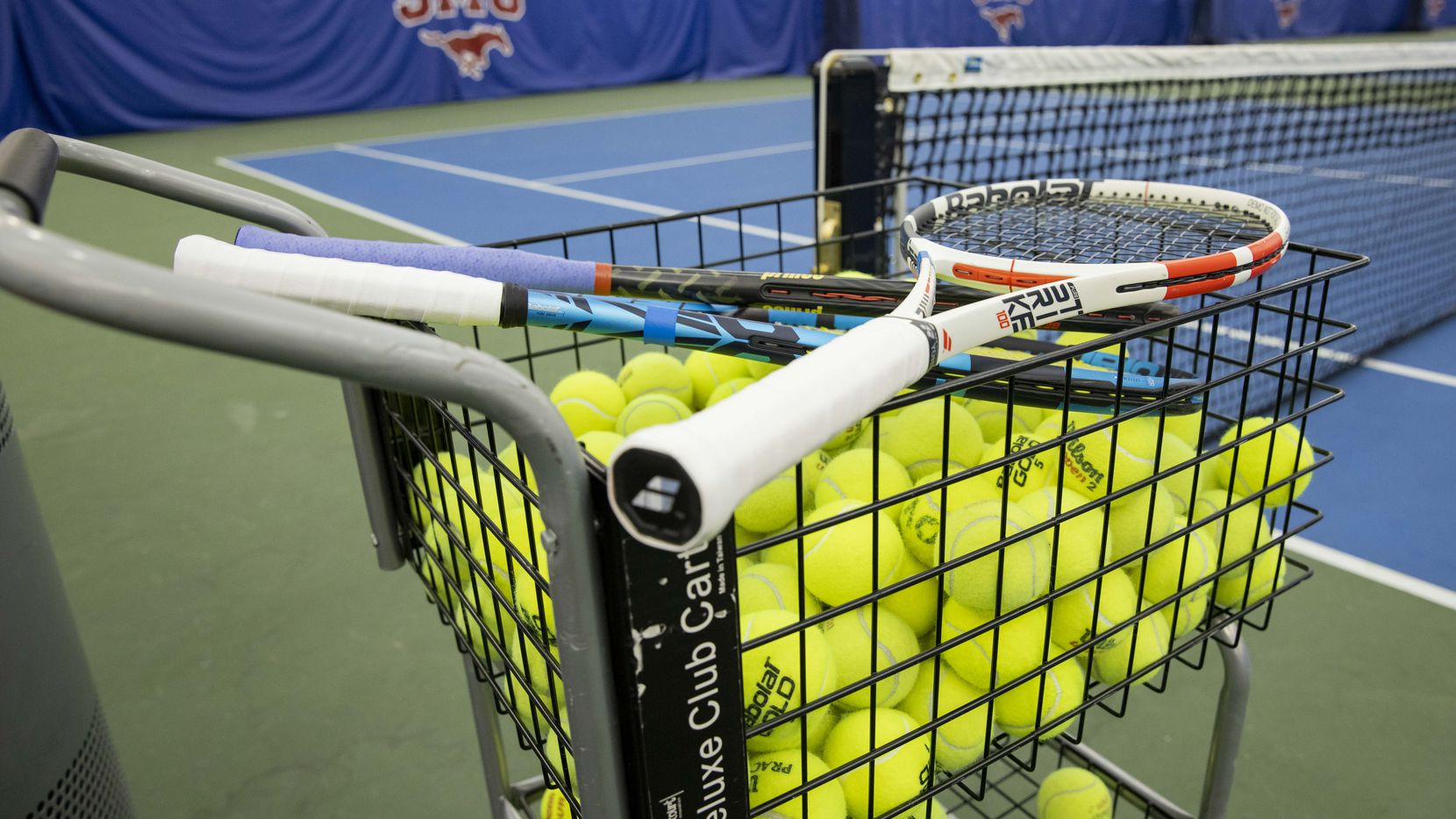 Tennis balls and racquets during a press conference to announce a new ATP tennis tour event coming to Dallas at the SMU Styslinger/Altec Tennis Complex on Wednesday, May 19, 2021, in Dallas. (Juan Figueroa/The Dallas Morning News)