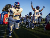Duncanville players, including defensive lineman Josiah Drake (51) and running back Kaleb Kenney (27) take the field before a high school football game against Mater Dei on Friday, Aug. 27, 2021, in Duncanville. (Smiley N. Pool/The Dallas Morning News)