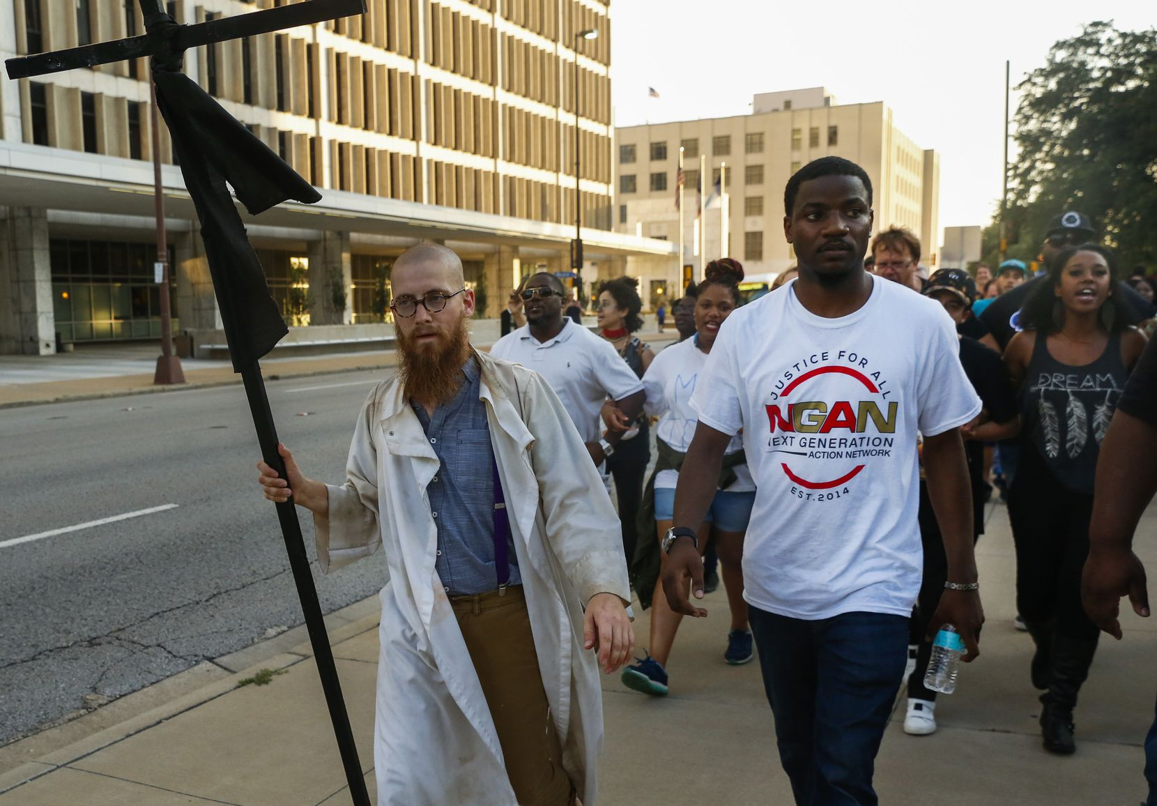 "The Rev. Dr. Jeff Hood, left, and Dominique Alexander lead protestors east on Commerce St during the ""Finish the March: A Defiance of Fear"" event on Thursday July 6, 2017. The protestors gathered at the Old Red Museum to finish last year's anti-police brutality march that was cut short by the Dallas Police ambush."