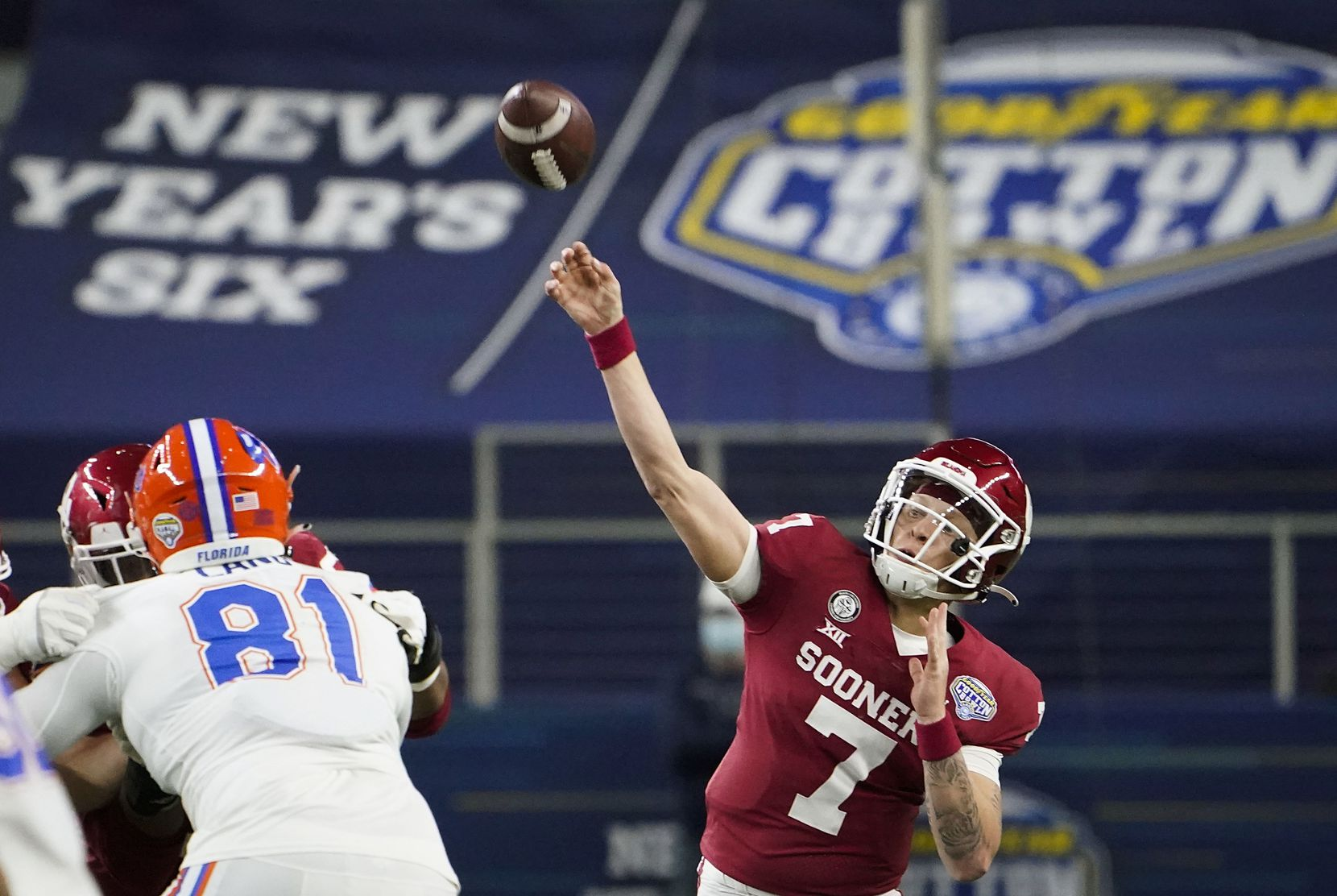 Oklahoma quarterback Spencer Rattler (7) throws a pass over Florida defensive lineman Dante Lang (81) during the first half of the Cotton Bowl Classic at AT&T Stadium on Wednesday, Dec. 30, 2020, in Arlington.