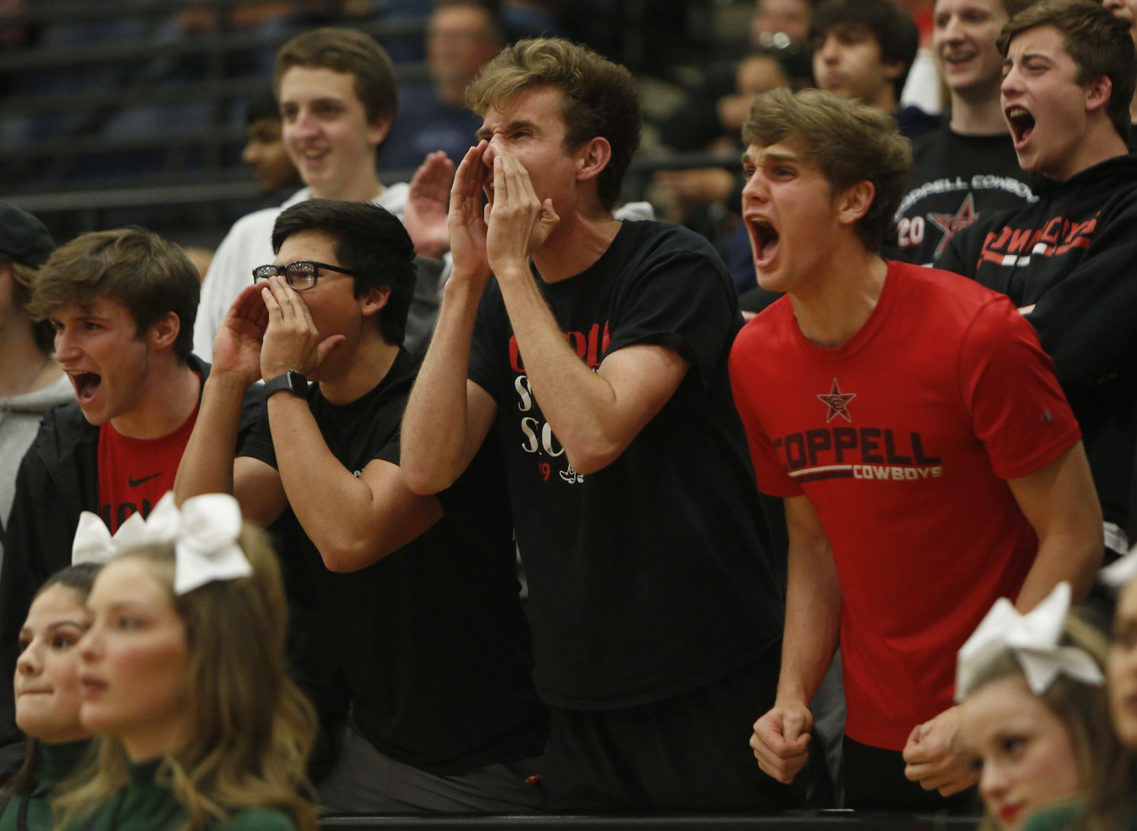 Coppell students voice their fan support during the first half against Waxahachie. The two teams played their Class 6A area-round boys basketball playoff game at Mansfield Timberview High School in Arlington on February 28, 2020.
