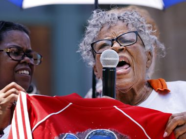 After cooling down from her march, Opal Lee, 94, (right) spoke to supporters outside the Tarrant County Courthouse in downtown Fort Worth, Saturday morning, June 19, 2021. For the first time since her dream of Juneteenth being made a national holiday became reality, Lee led a two-and-a-half mile caravan from Historic Southside to the courthouse. Earlier that week, the civil rights icon stood by President Joe Biden as he signed a law making Juneteenth a federal holiday.