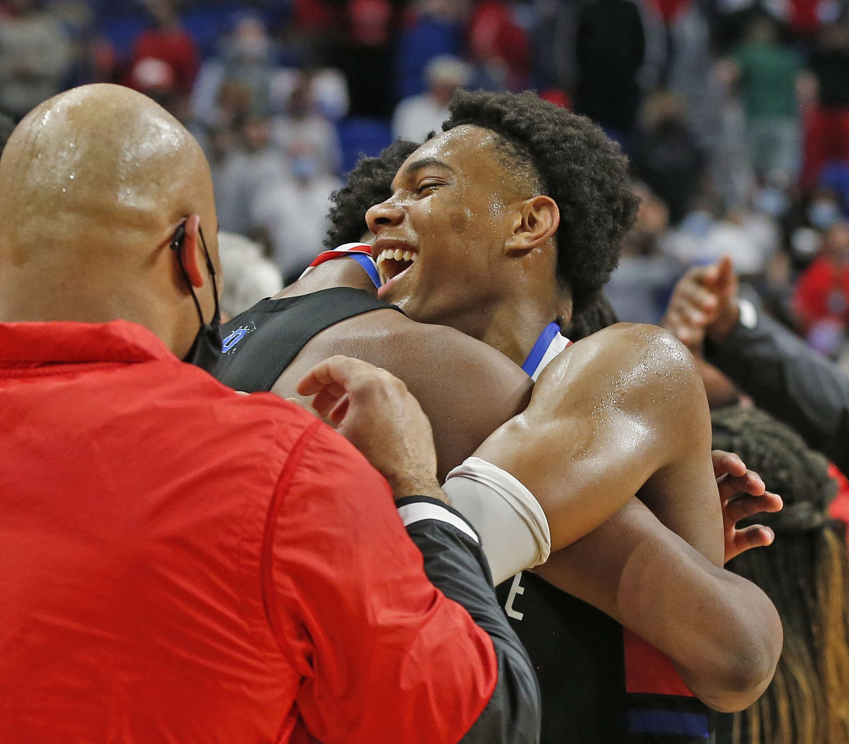 Duncanville Zhuric Phelps #0 is hugged by teammates. UIL boys Class 6A basketball state championship game between Duncanville and Austin Westlake on Saturday, March 13, 2021 at the Alamodome.