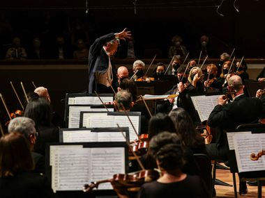 Music director Fabio Luisi conducts the Dallas Symphony Orchestra in Aaron Copland's Organ Symphony at the season opener in Dallas on Sept. 16, 2021.