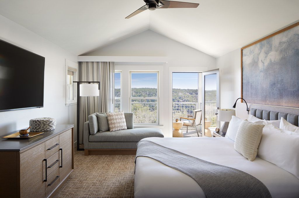 A king bedroom at Miraval Austin is outfitted in peaceful neutral tones, with beds that you truly sink into. The resort boasts 117 guest rooms and suites.