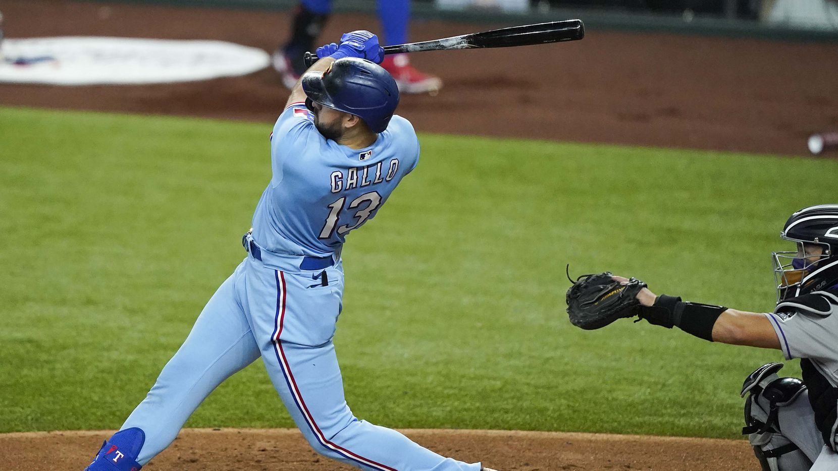 Texas Rangers outfielder Joey Gallo hits the first official home run in the history of the new ballpark during the second inning against the Colorado Rockies at Globe Life Field on Sunday, July 26, 2020.