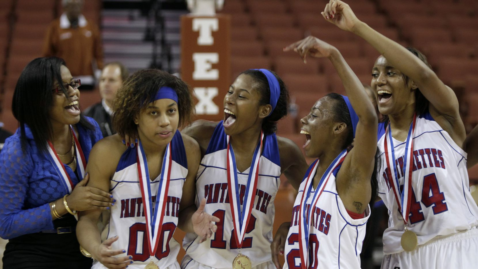 3/2/13  - Duncanville's Kiara Perry (00) is cheered on by her teammates after being announced the 5A Girls MVP in the Pantherettes victory over Cibolo Steele in the UIL Girls 5A state basketball championship in Austin, Texas March 2, 2013. (Erich Schlegel/Special Contributor)