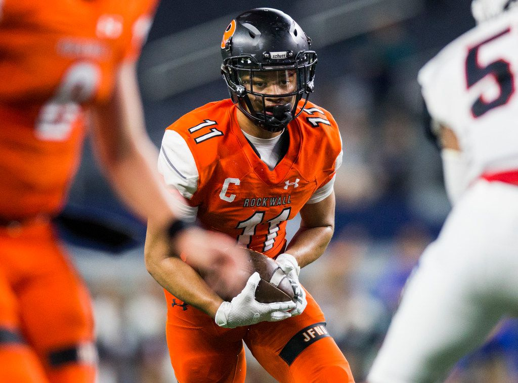 Rockwall wide receiver Jaxon Smith-Njigba (11) looks for an opening during the third quarter of a Class 6A Division I area-round high school football playoff game between Allen and Rockwall on Friday, November 22, 2019 at AT&T Stadium in Arlington. (Ashley Landis/The Dallas Morning News)