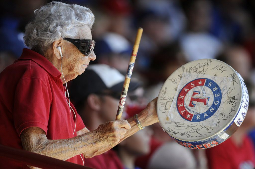 Sister Frances Evans, 84 of Fort Worth, tries to pump up the surrounding fans with her drum during the fourth game of the ALDS between the Texas Rangers and Tampa Bay Rays at the Ballpark at Arlington on Oct. 10, 2010.  Evans has come to almost every  Rangers games since 1972. A friend gave her the drum which is signed by all the players of the 2003 team. The Rays defeated the Rangers 5-2, forcing a game 5 in Tampa.  (Brendan Sullivan/The Dallas Morning News) 10152010xNEWS