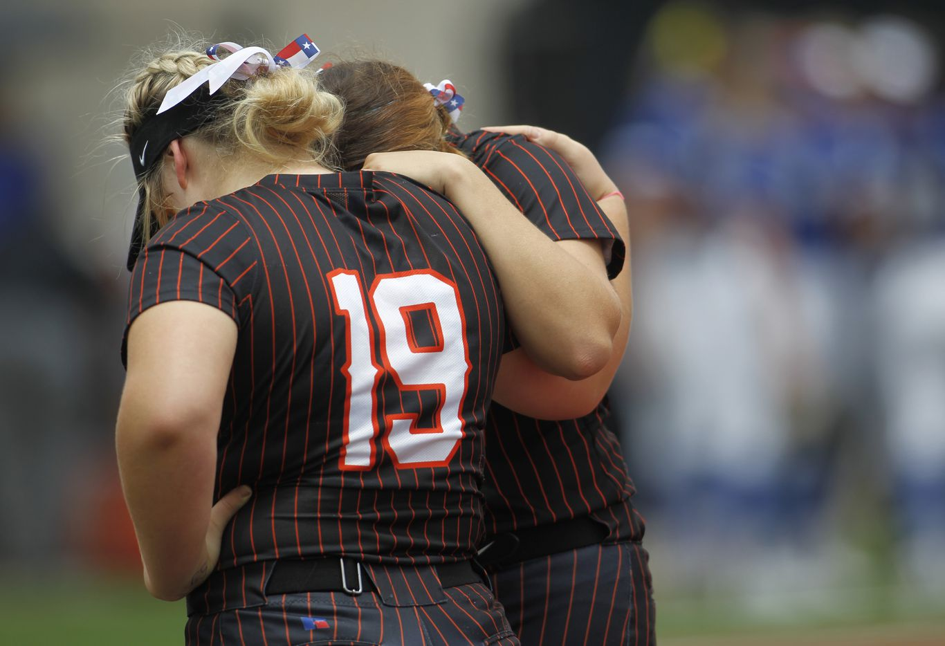 Aledo teammates Texas Ray (19) pauses to pray with a teammate at first base prior to the start of their game against Georgetown.  The two teams played their UIL 5A state softball semifinal game at Leander Glenn High School in Leander on June 4, 2021. (Steve Hamm/ Special Contributor)