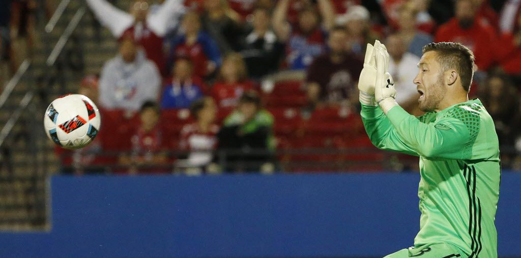 FC Dallas goalkeeper Chris Seitz (18) attempts to make a save in the first half of a Major League Soccer match between Columbus Crew SC and FC Dallas at Toyota Stadium in Frisco, Texas Saturday April 2, 2016. Columbus Crew led FC Dallas 1-0 at the half. (Andy Jacobsohn/The Dallas Morning News)