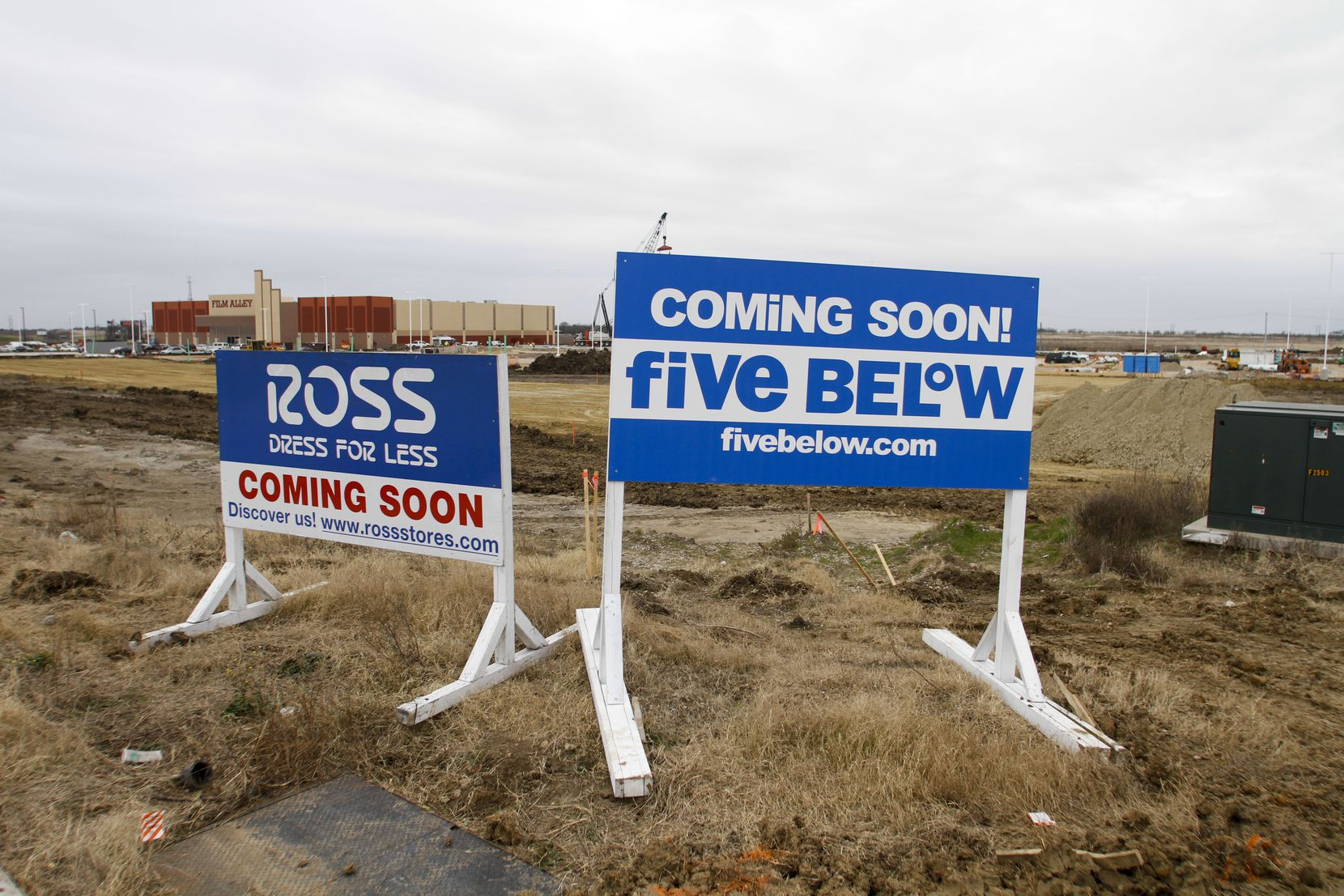 Signs for a new Ross Dress For Less and Five Below that will be part of a large shopping complex under construction across the street from the Buc-ee's in Terrell