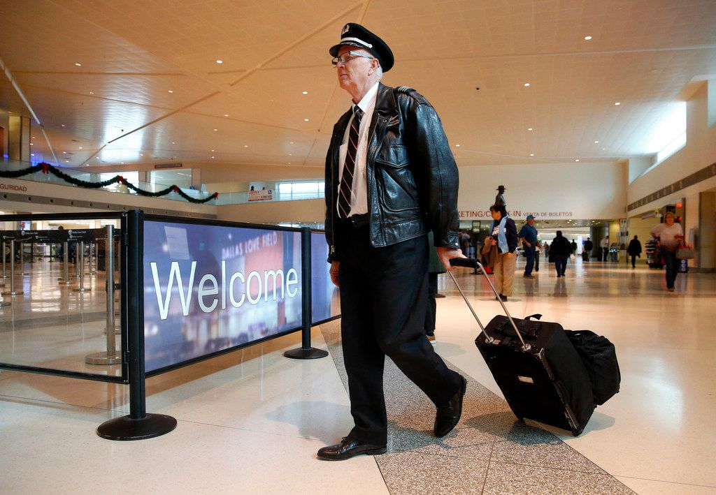 Southwest Airlines captain Kyle McDaniel arrives for work at Dallas Love Field, Wednesday, December 6, 2017.