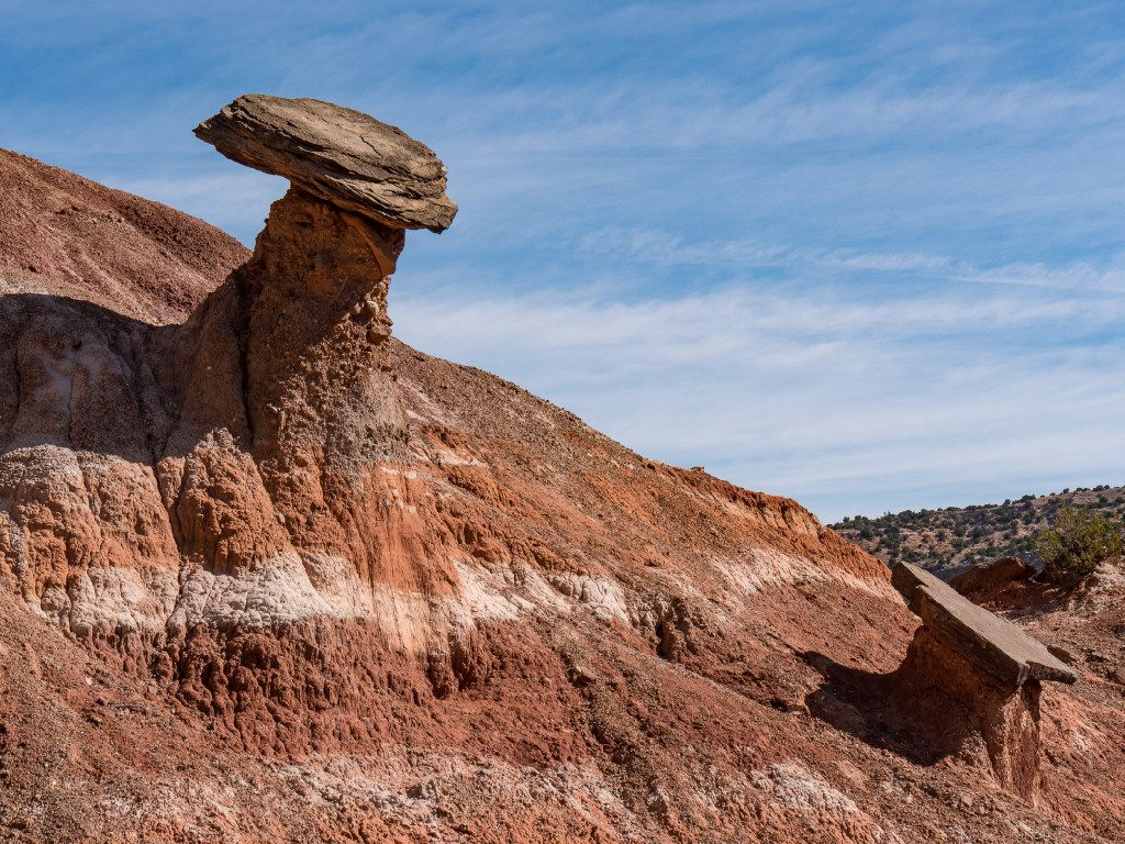 A pair of balanced rocks stand near Palo Duro Canyon State Park's Pioneer Amphitheater. A pair of balanced rocks stand  near Palo Duro Canyon State Park's Pioneer Amphitheater.