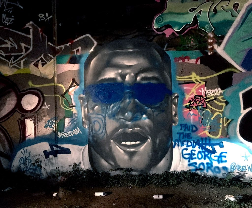 By Sunday night, Aug. 5, 2018, blue glasses and other elements had been added on top of the image of Dak Prescott's face, originally painted by artist Trey Wilder.