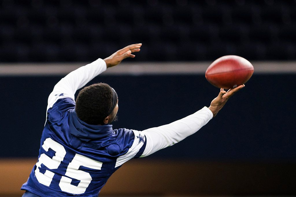 Dallas Cowboys safety Xavier Woods (25) reaches for a pass during a team OTA practice at The Star on Wednesday, June 5, 2019, in Frisco. (Smiley N. Pool/The Dallas Morning News)
