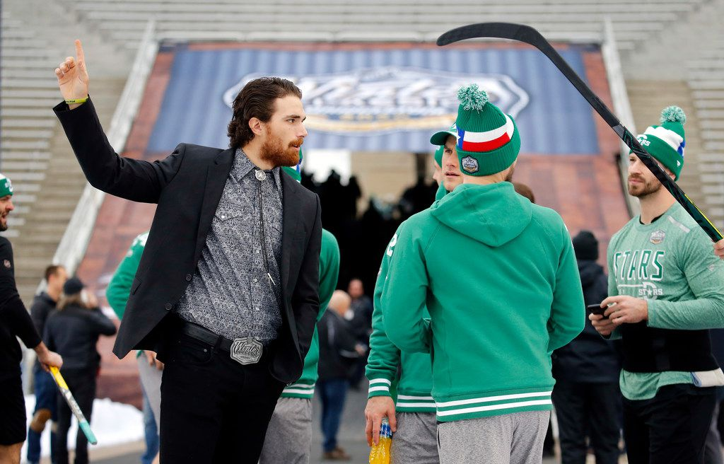 Dallas Stars injured player Stephen Johns (left) visits with his teammates as they get acclimated to the cold weather before the NHL Winter Classic hockey game against the Nashville Predators at the Cotton Bowl in Dallas, Wednesday, January 1, 2019. (Tom Fox/The Dallas Morning News)