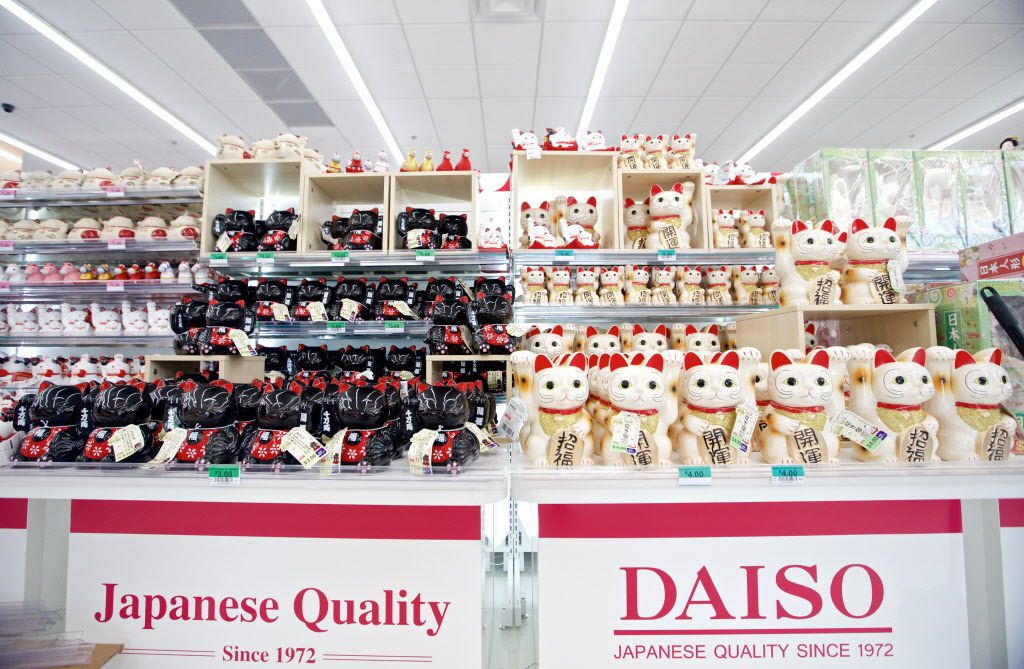 "Japanese ""Lucky Cats"" for sale at Daiso, a Japanese dollar store, in Carrollton. The store opened today. (Brandon Wade/Special Contributor)"