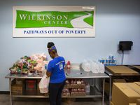 Get Shift Done worker Shkoryah Carthen prepares a bag of food at the Wilkinson Center in Dallas. Carthen, a former server at Bob's Steak & Chop House, says working for Get Shift Done helps take some weight off her shoulders while helping others.