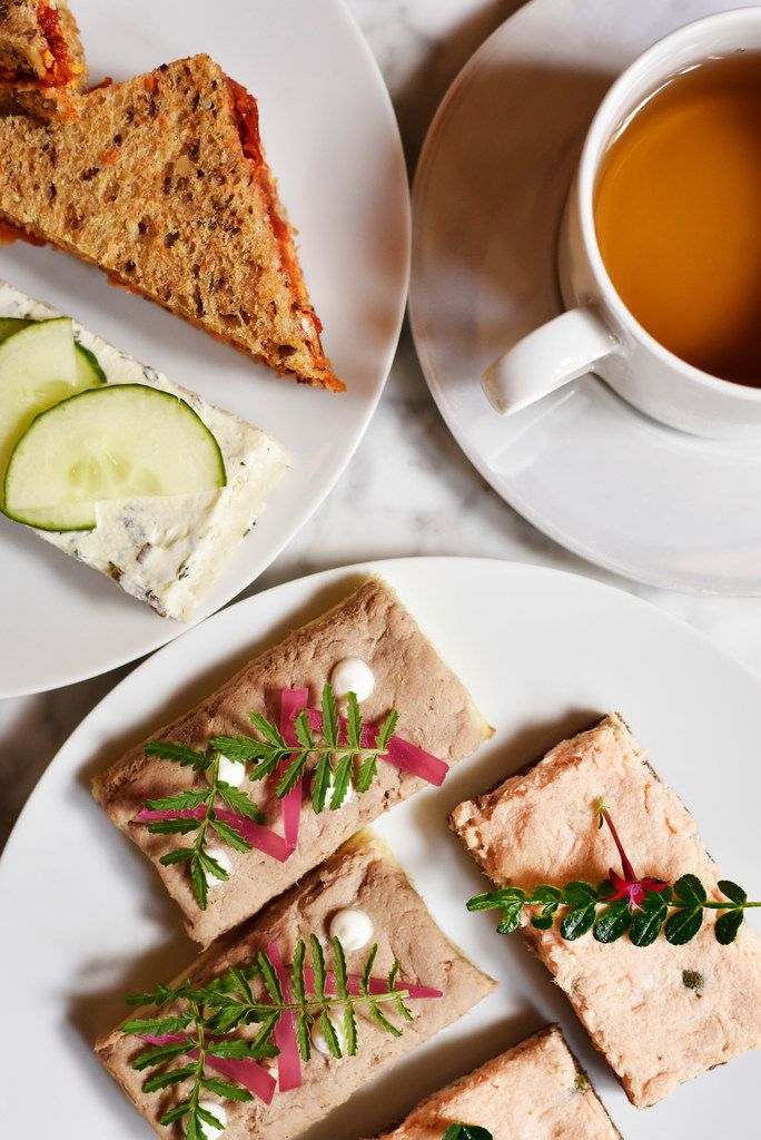 Sandwiches of ratatouille and Devonshire cheddar, and cucumber with cream cheese, mint and chives, top left, salmon rillette and capers, and duck confit with foie gras, bottom, and Moonlight Beauty Pu-erh tea.