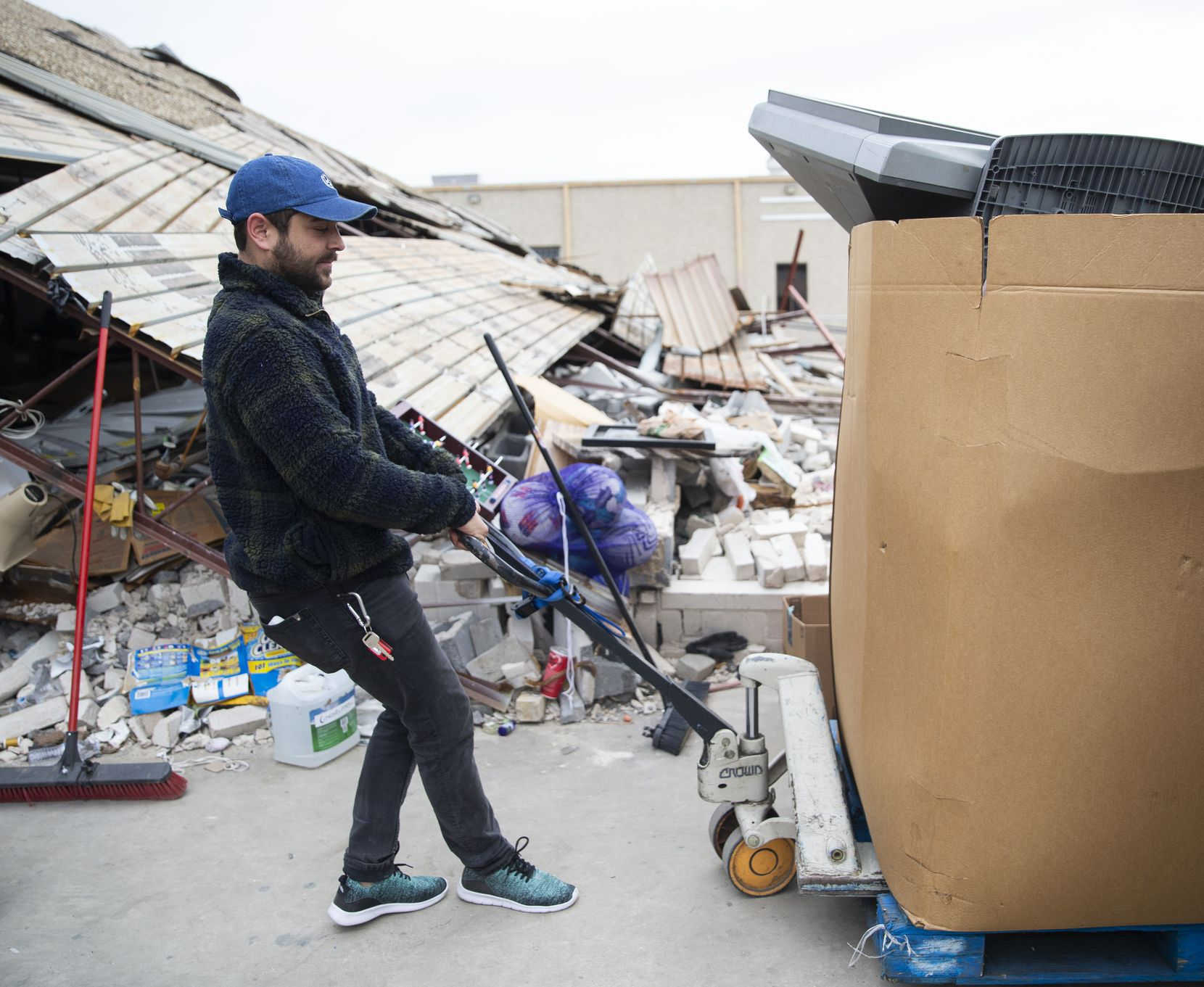 David Peganyee continues to run his charitable donation business despite the building having destroyed his warehouse on Composite Drive near Walnut Hill Lane and Stemmons Freeway.
