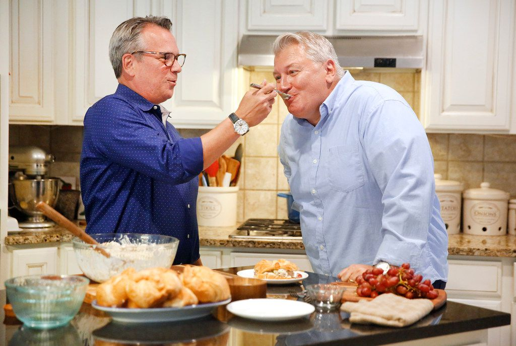Married couple Kris Longwell (left) and Wesley Loon run a food blog called How To Feed A Loon and was also recently on Guy's Grocery Games, a Food Network show. They are making their Best Ever Chicken Salad in the kitchen of their Flower Mound, Texas home.
