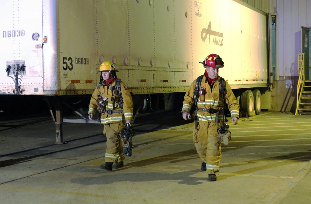 Steph Bouillon, 27, a Garland firefighter-Paramedic, left, and Captain Casey Lindsay of fire station 2 in Garland, returned to the fire truck after answering a fire alarm call to a business in Garland on Thursday, October 15, 2015. When Steph Bouillon completed the Garland fire academy earlier this year, she became just one of two women hired onto the department in nearly 15 years. (David Woo/The Dallas Morning News)
