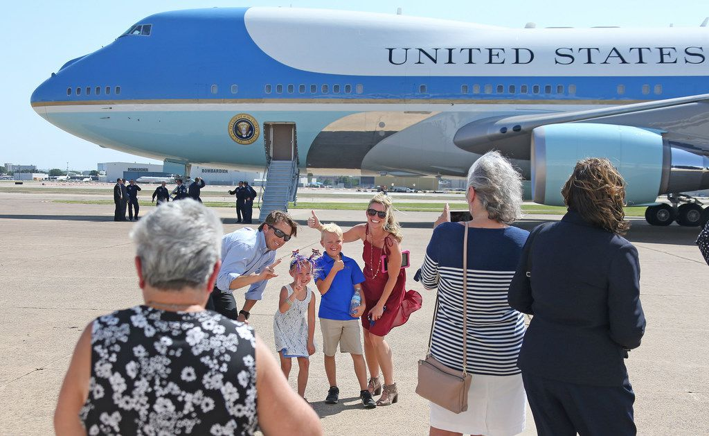 The Knutowski family from Trophy Club, Texas, poses for a photo in front of Air Force One after United States President Donald Trump arrives at Love Field in Dallas on Thursday, May 31, 2018.