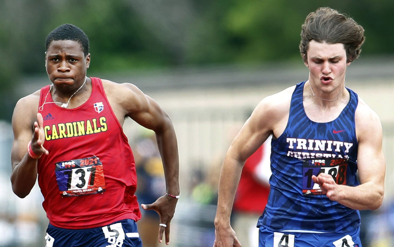 Trinity Christian-Addison's Luke Tredennick (right) races to victory in the TAPPS 6A boys 100-meter dash, running 11.22 on Saturday at the TAPPS state track and field meet at Waco Midway's Panther Stadium.