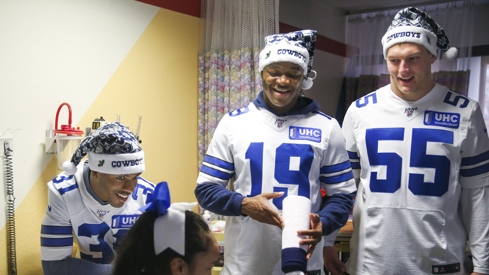 "Dallas Cowboys cornerback Byron Jones (31) chats with Deshony ""Shony"" Caraway, 12, along with wide receiver Amari Cooper (19) and outside linebacker Leighton Vander Esch (55) during the team's annual holiday visit to local children hospitals on Monday, December 9, 2019 at Texas Scottish Rite Hospital for Children in Dallas. (Shaban Athuman/Staff Photographer)"