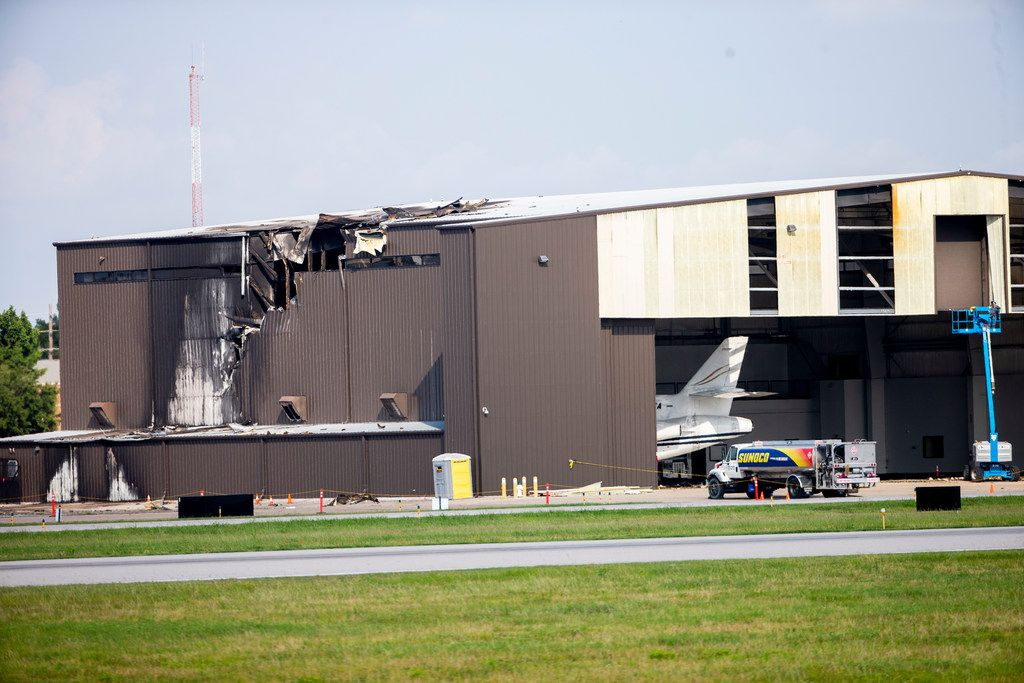 A hangar was badly damaged when a twin-engine plane crashed into it Sunday morning at Addison Airport