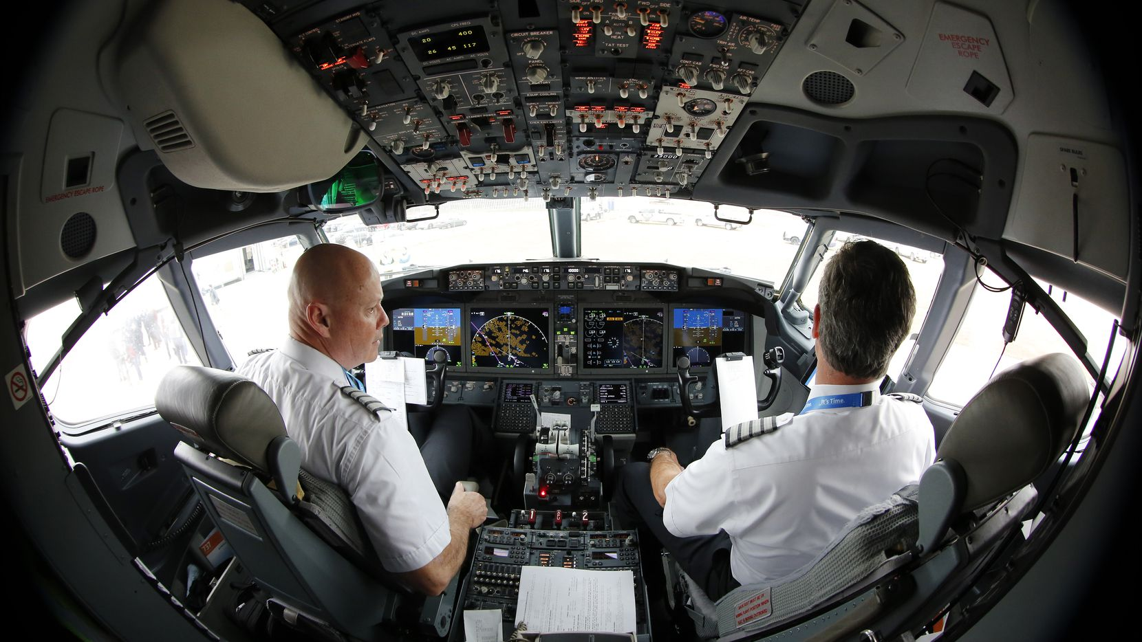 American Airlines Captain Pete Gamble (left) and First Officer John Konstanzer perform a pre-flight check of their Boeing 737 MAX aircraft before taking off from Dallas-Fort Worth International Airport en route to Tulsa in December.