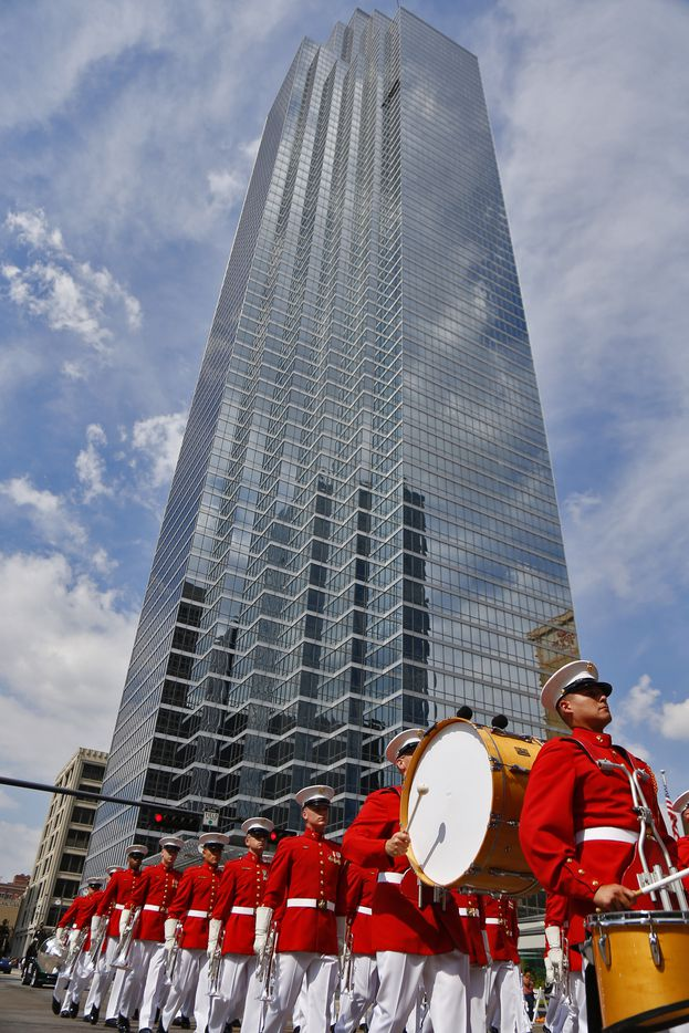 The Marine Corps Drum and Bugle Corps plays in front of the Bank of America Building during the State Fair of Texas opening day parade down Main St. Sept. 26, 2014, in Dallas.